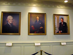 Portraits of Thomas Jefferson, Woodrow Wilson, and Ronald Regan in the Hall of Presidents